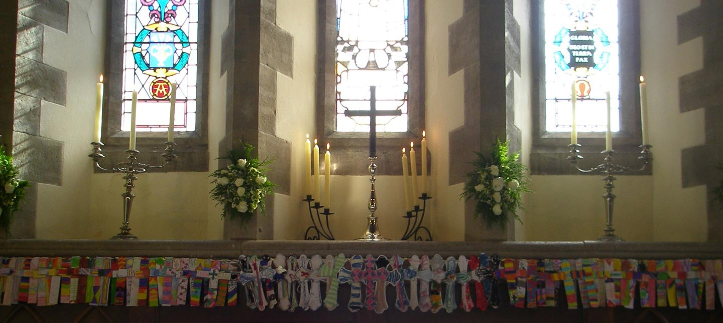 Each year the children of St Mark's School create new painted crosses for behind the altar at St Mark's Church