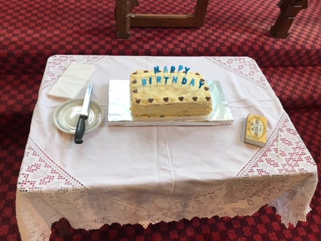 The cake with liturgical preparation for lighting and cutting!