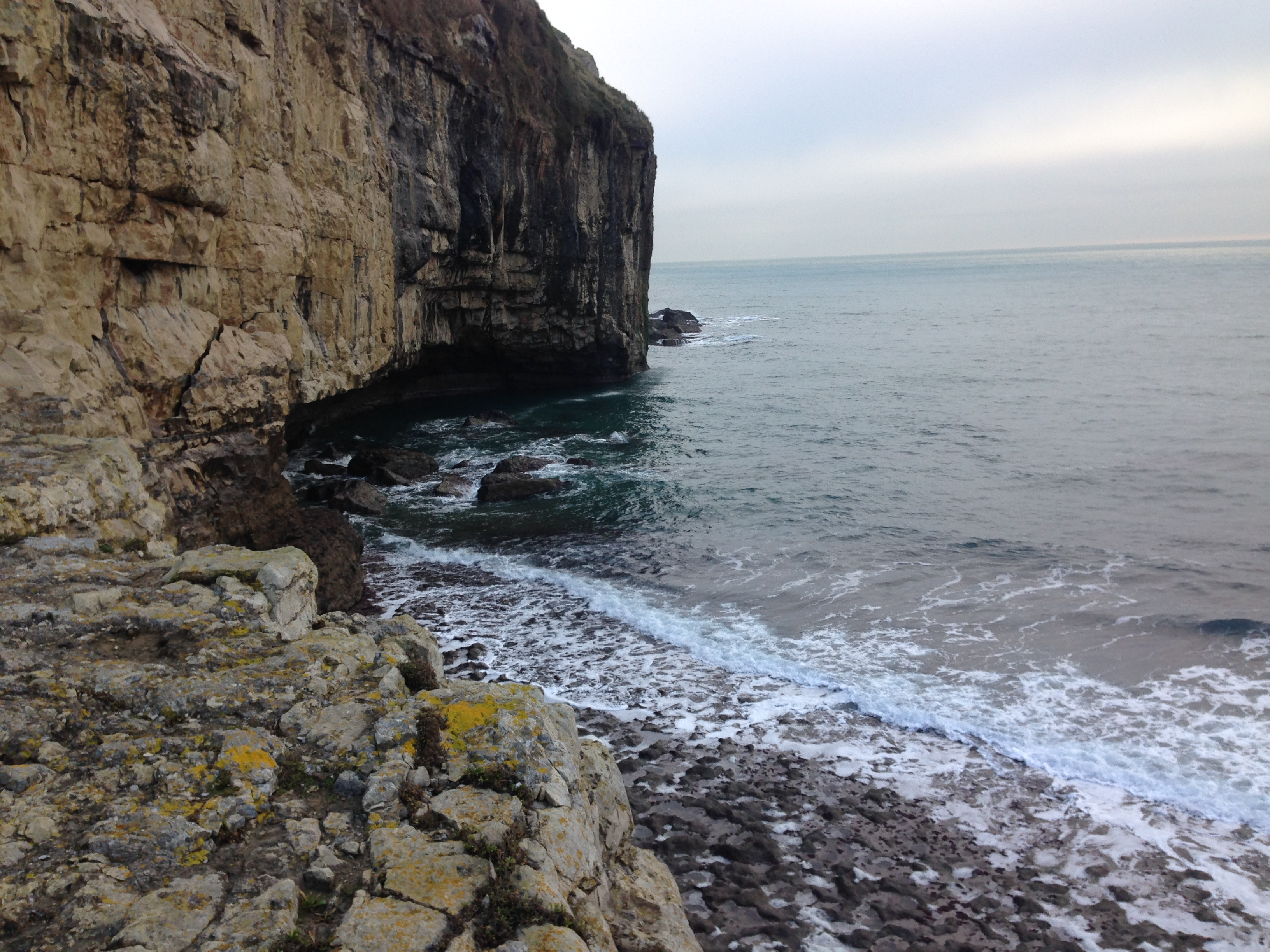 Looking back from where we sat, as the sea relentlessly undermines the cliff